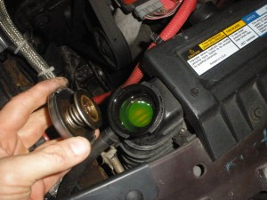 Check Antifreeze coolant level at Radiator cap